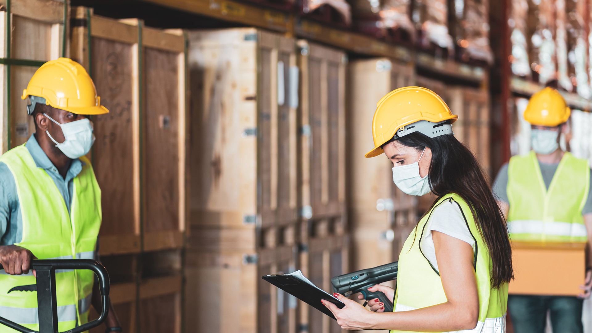 Diversity workers wear protective face mask in warehouse