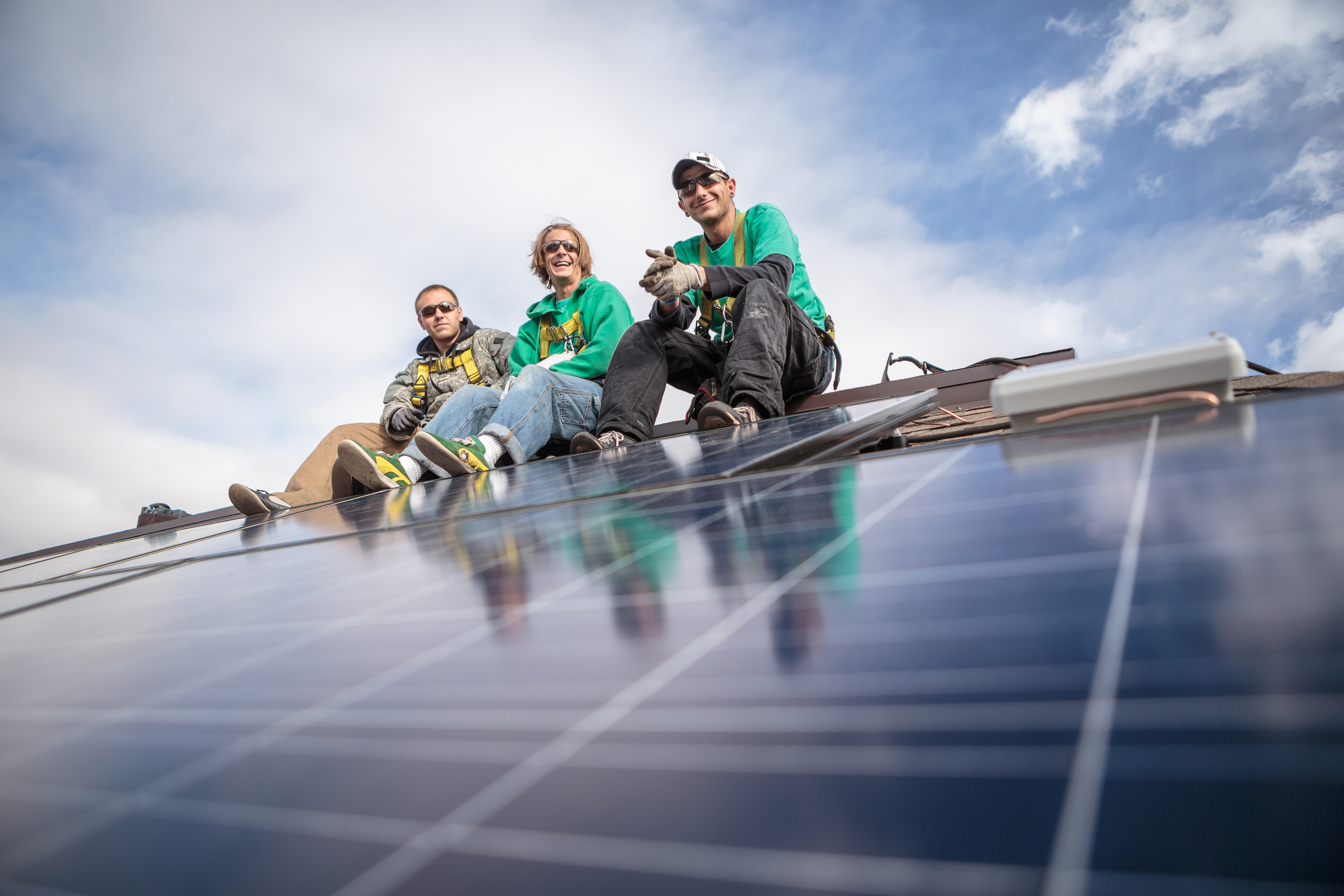 Construction crew taking break from installing solar panels on a house