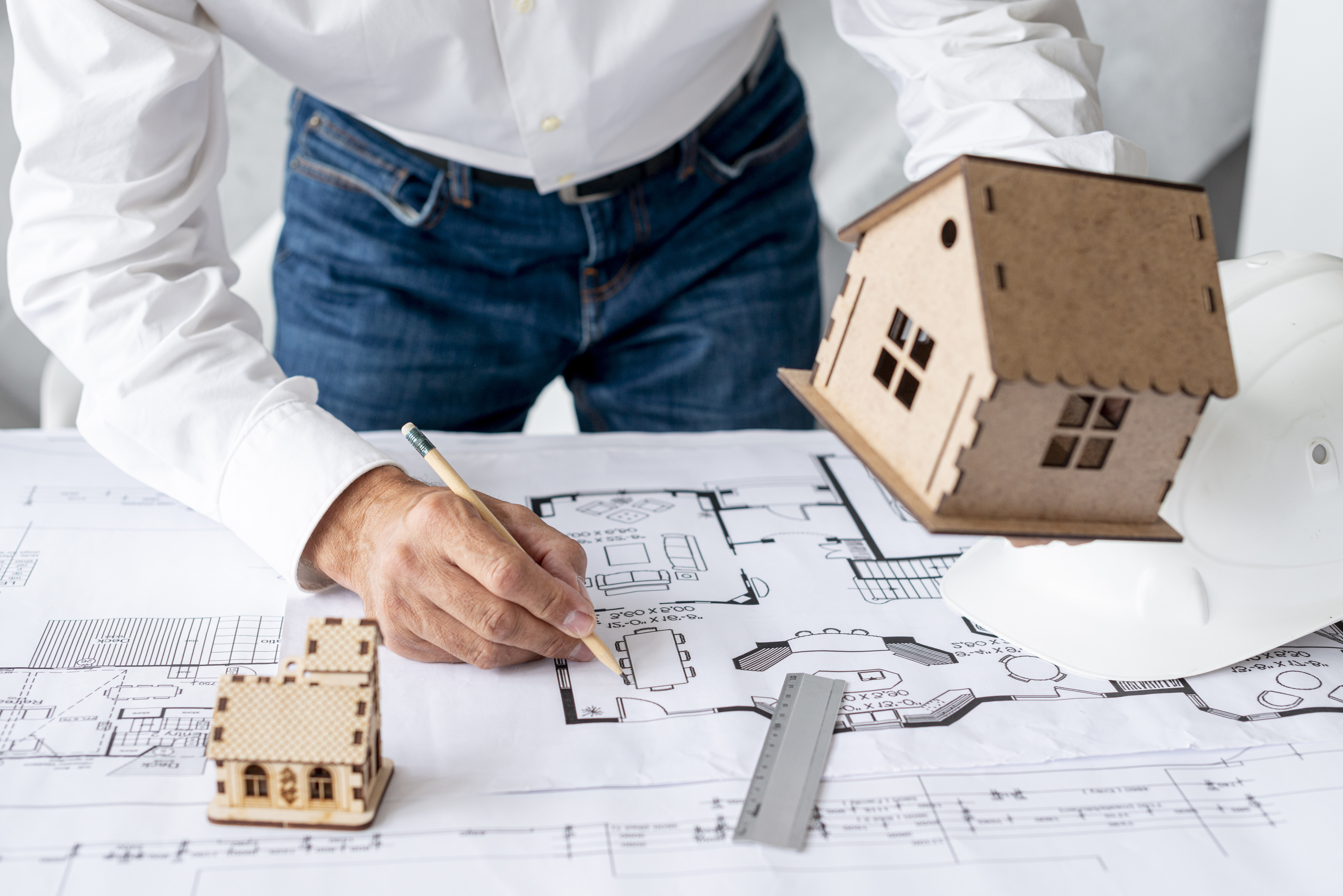 architect-showing-miniature-projects.jpg