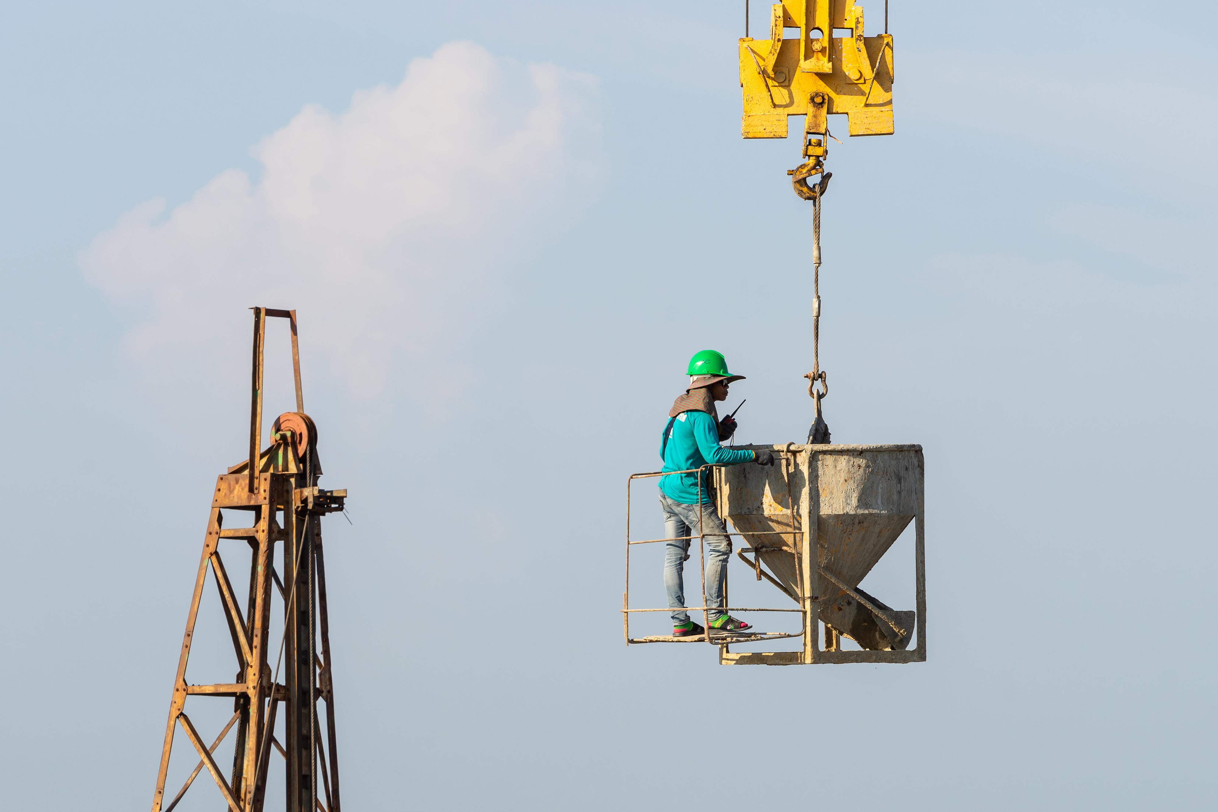 workers-work-crane-construction-site.jpg