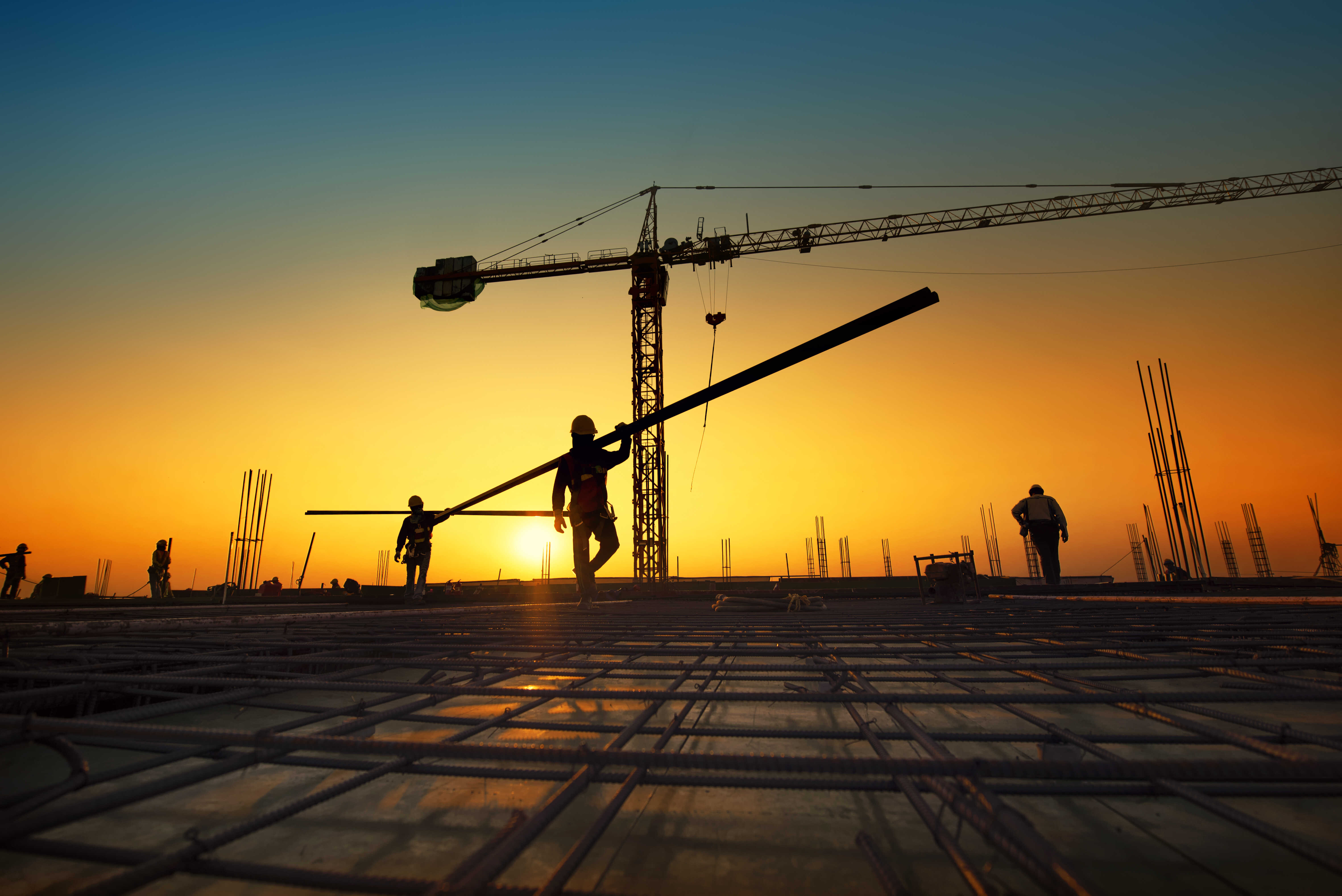 silhouette-construction-workers-fabricating-steel-reinforcement-bar-construction-si (1).jpg