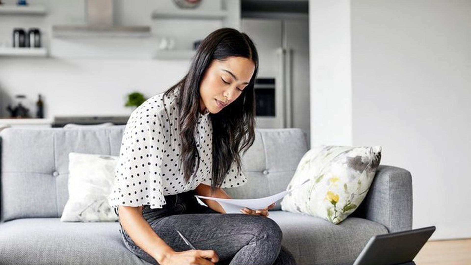 asian woman checking debt.jpg