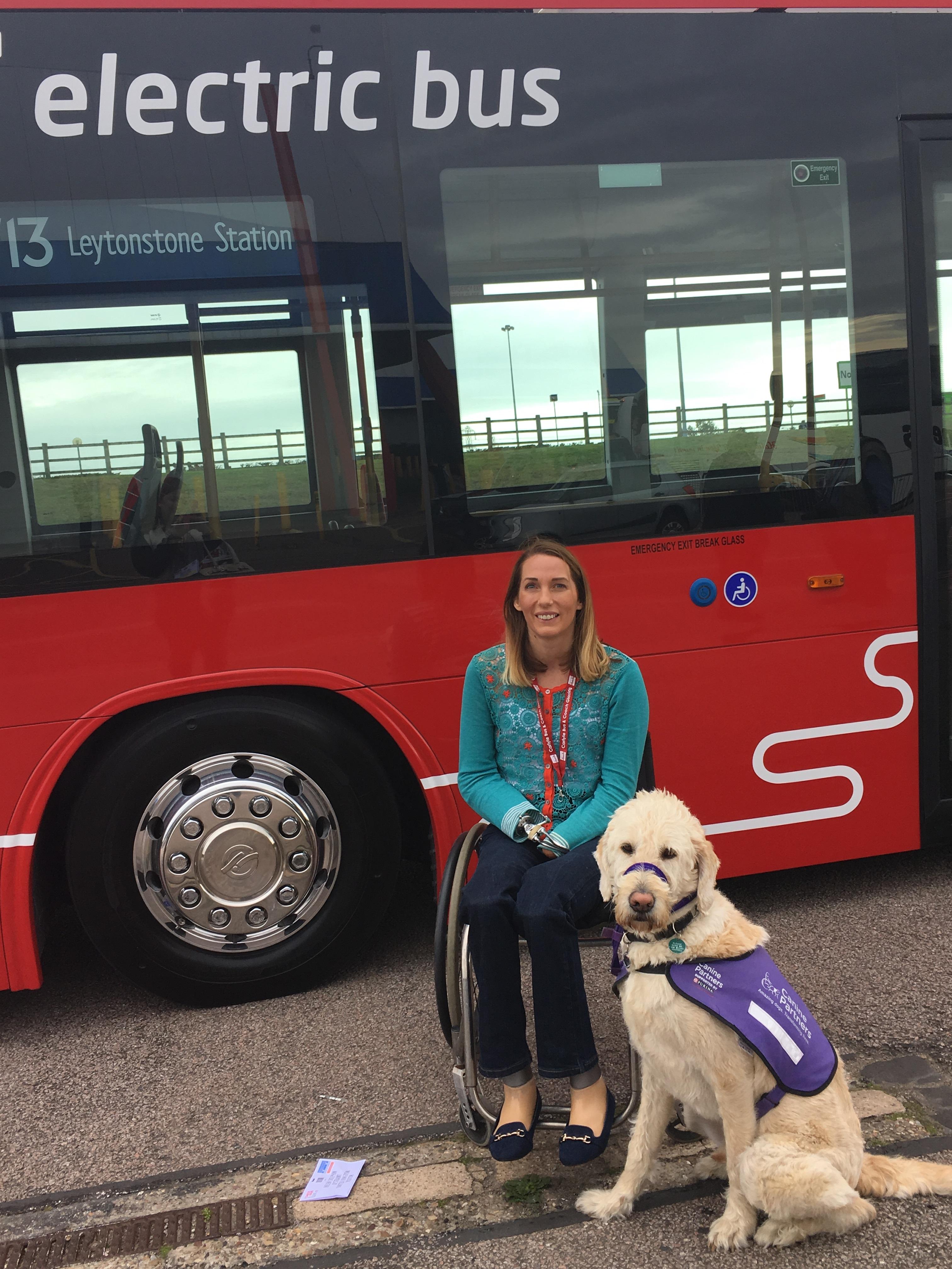A guide dog sits beside Helen