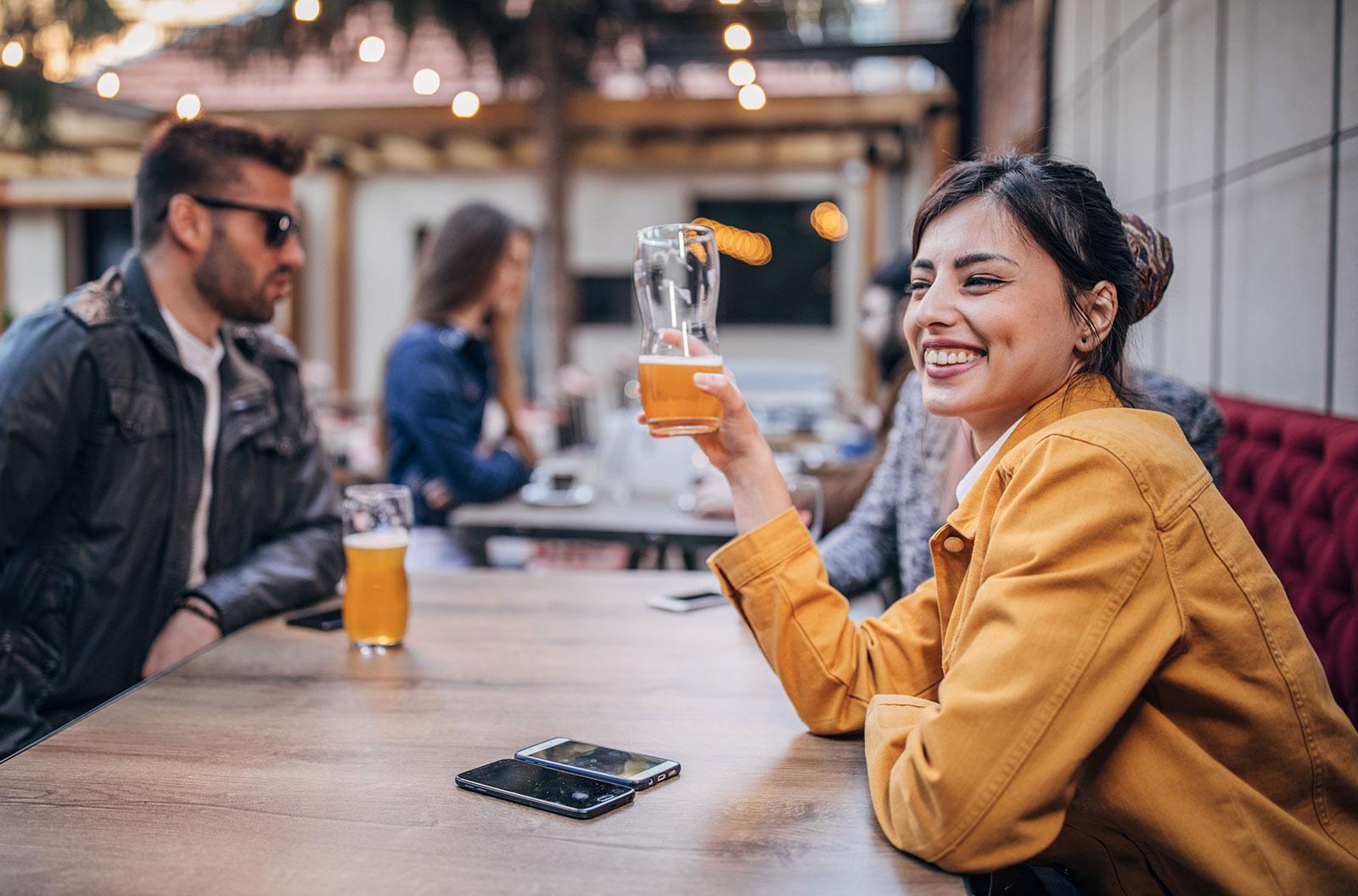 People drinking beer in a pub garden