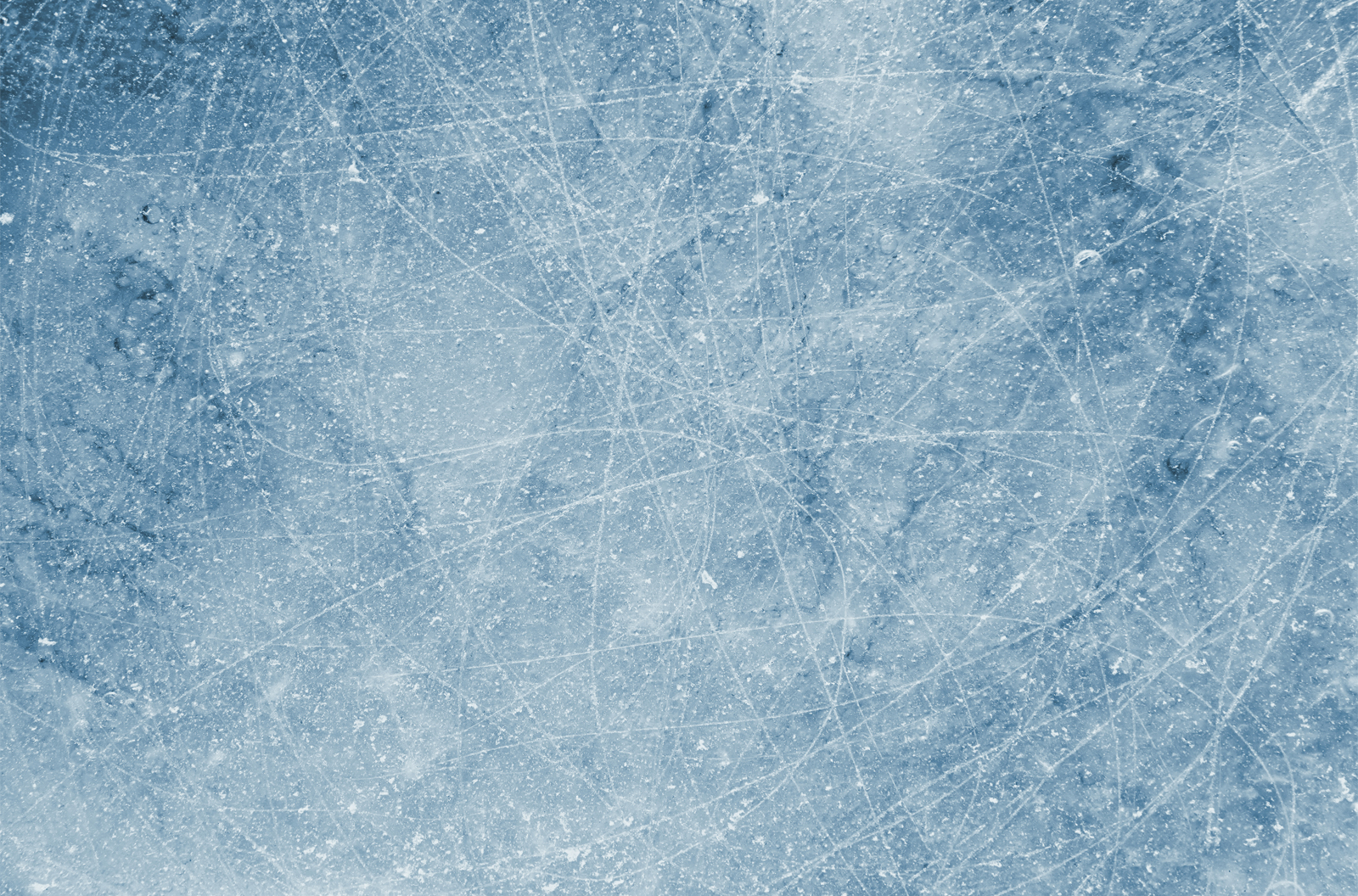 Close-up image of an ice background with many scratches