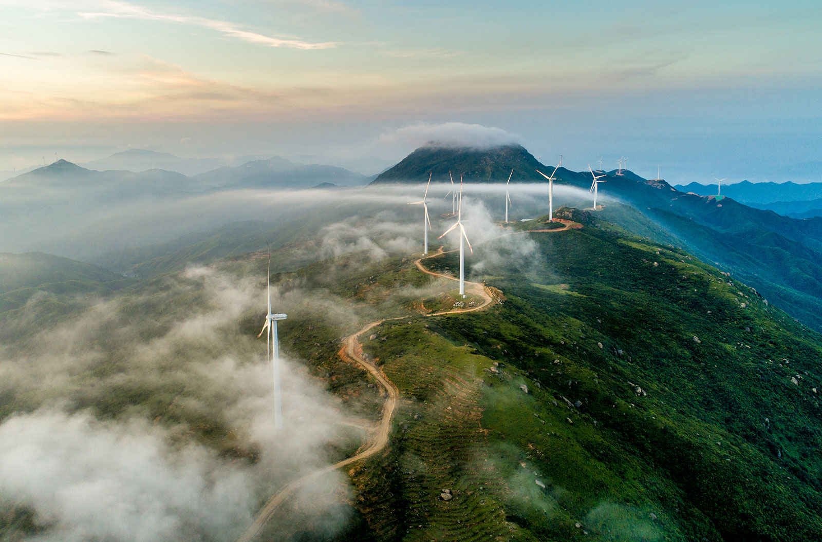 Aerial shot of a wind turbine field on the ridge of a mountain