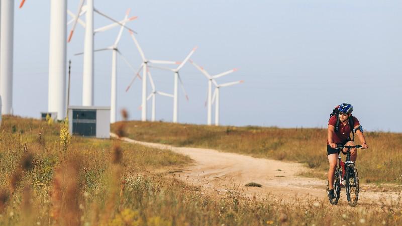 man-cycling-through-windfarm-aegon.jpg