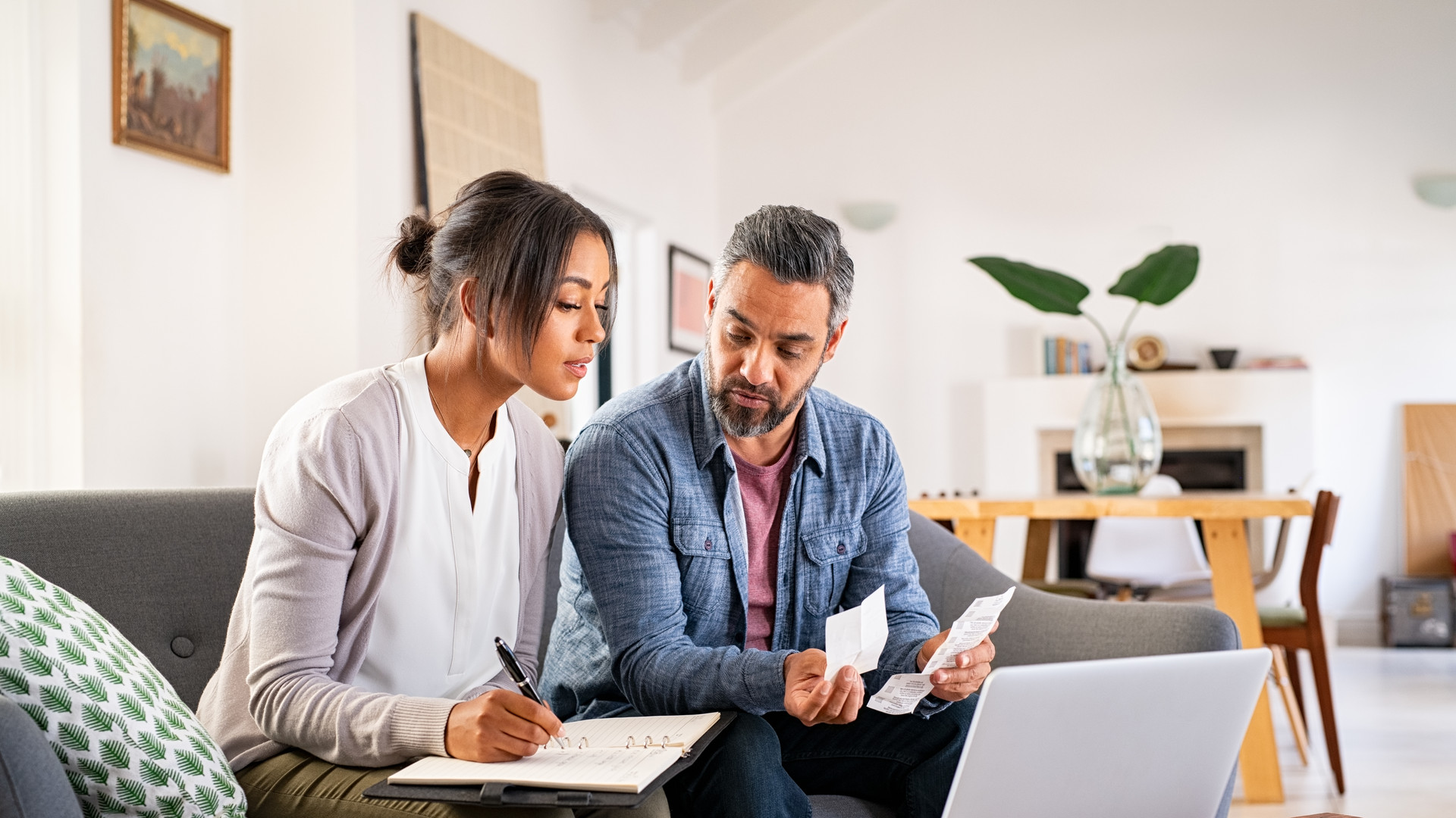 Mid adult couple working on home finance