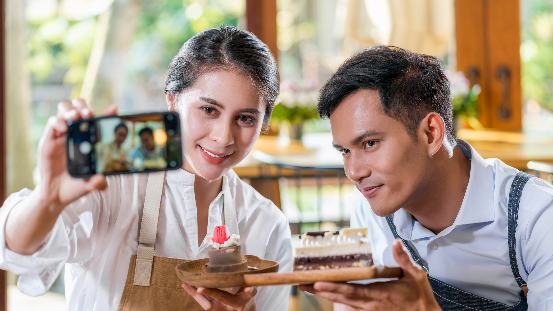 Couple Asian two partner of small business owner taking selfie and presenting the bakery in coffee shop when reccord vlog, Cake and dessert, entrepreneur blogger and startup business concept