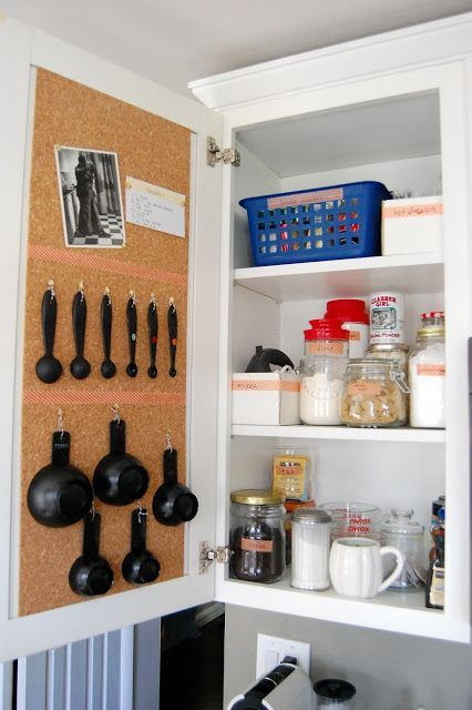 12 Easy Kitchen Organization Tips _ Cork board inside of kitchen cabinets to pin recipes and hooks for measuring spoons_.jpg