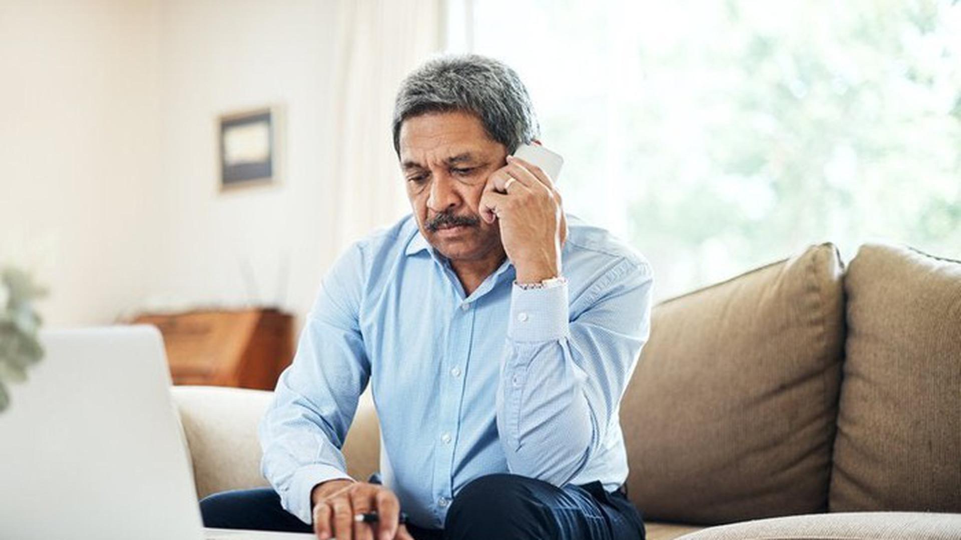 Hispanic man on phone.jpg