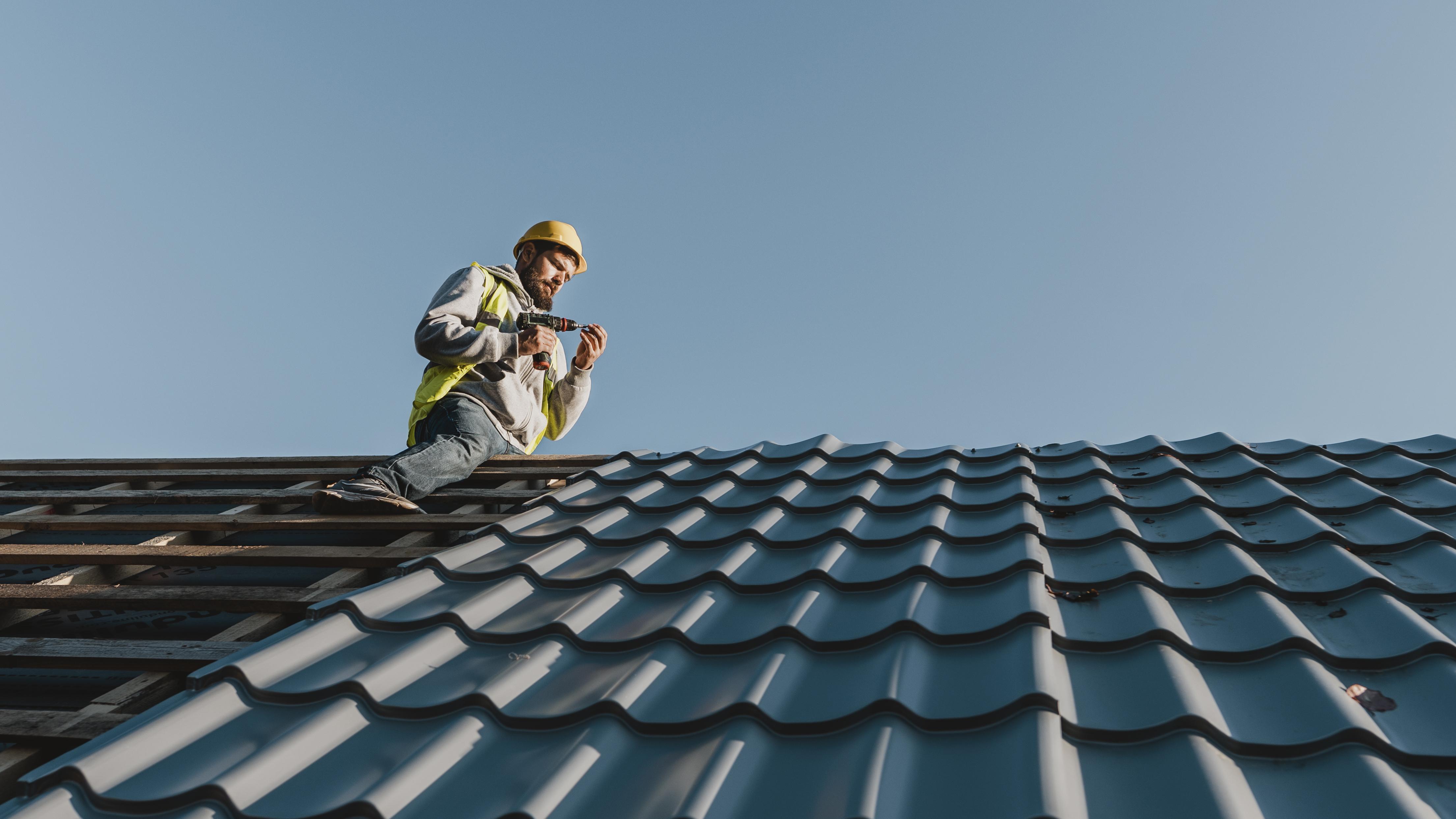 long-shot-man-working-roof.jpg