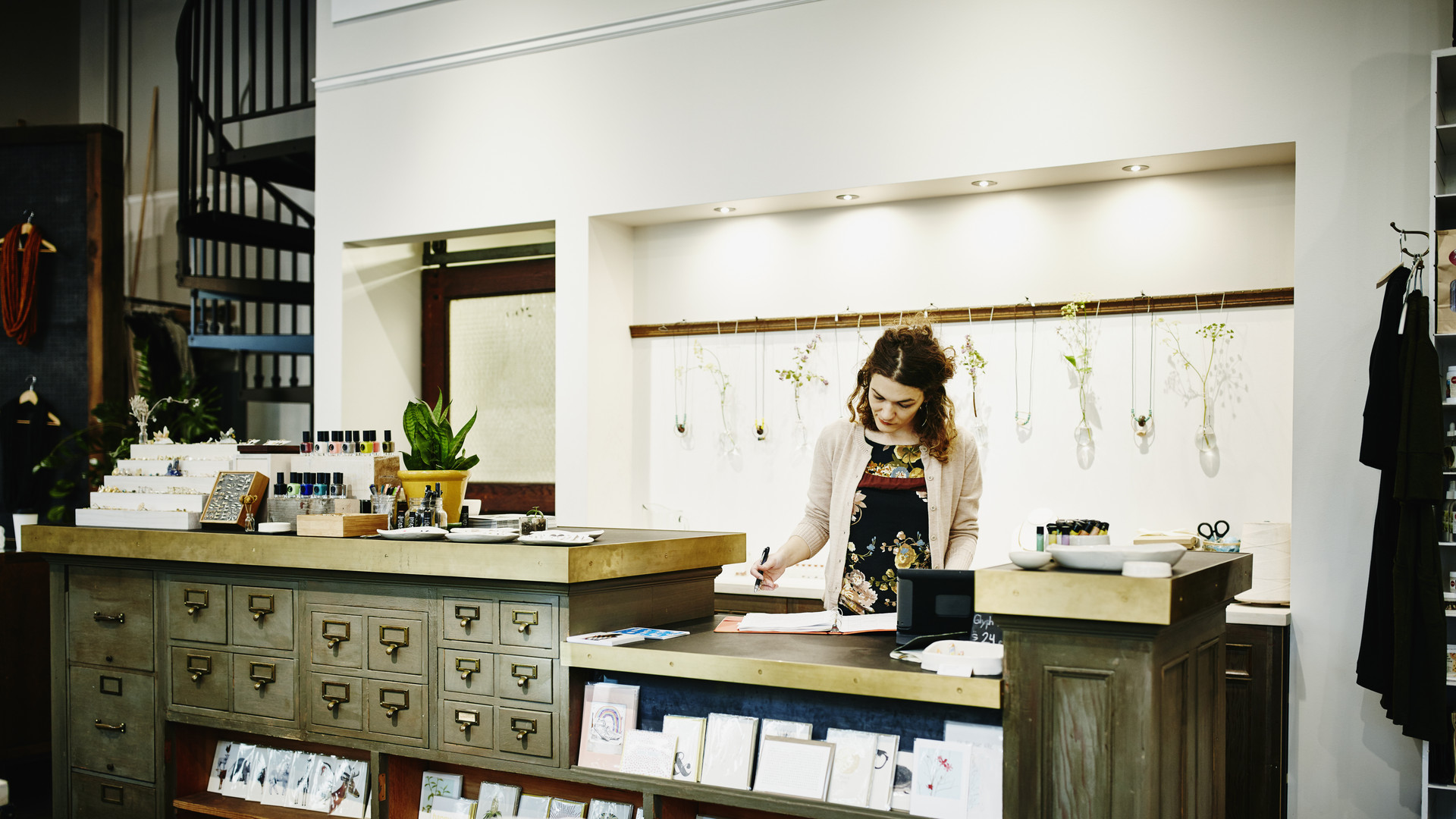 Female business owner managing inventory of shop