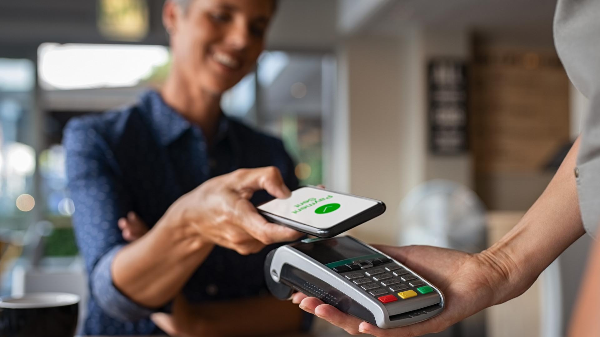 Woman paying using NFC technology