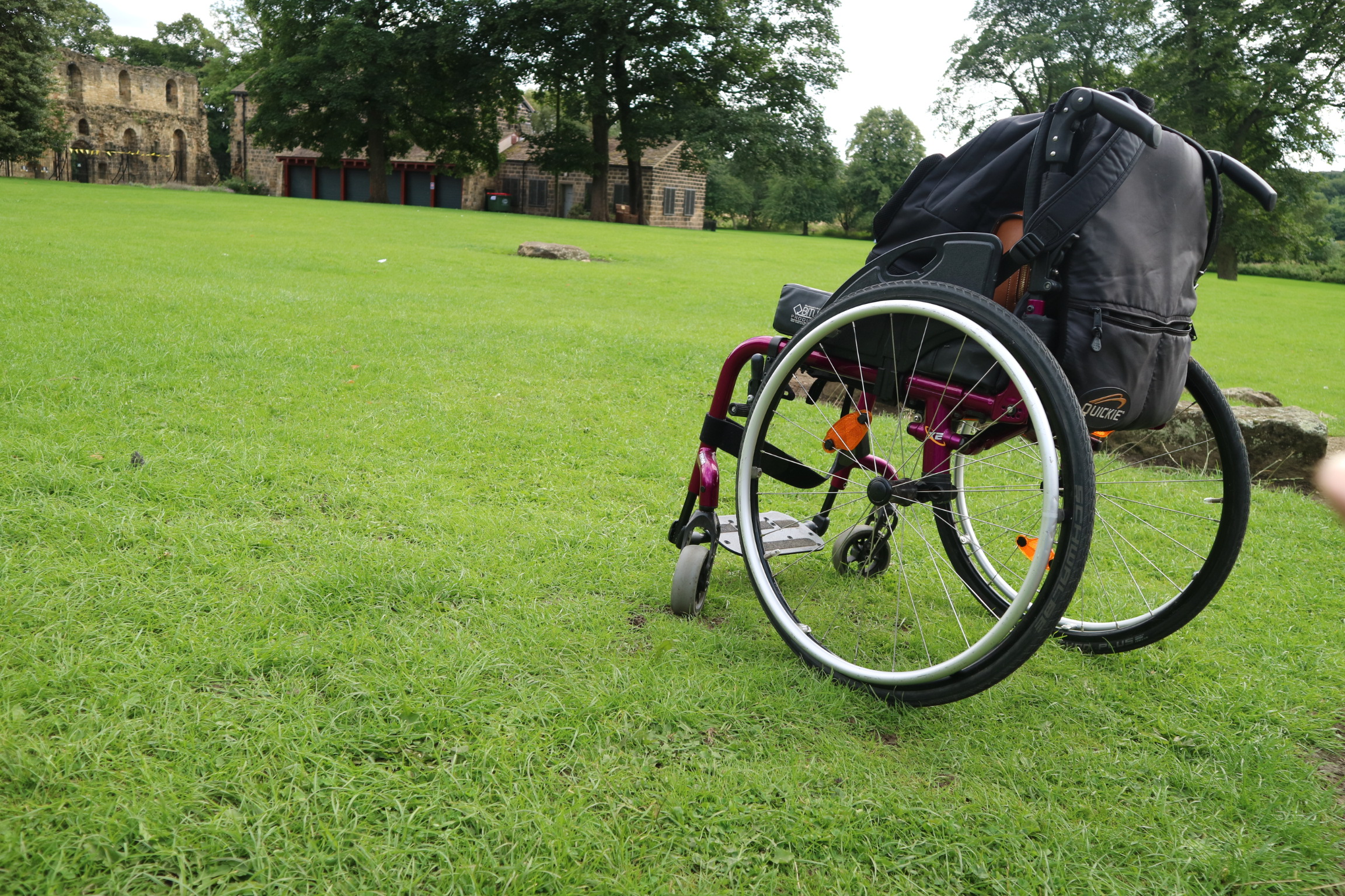 a wheelchair with accessories and mobility aids