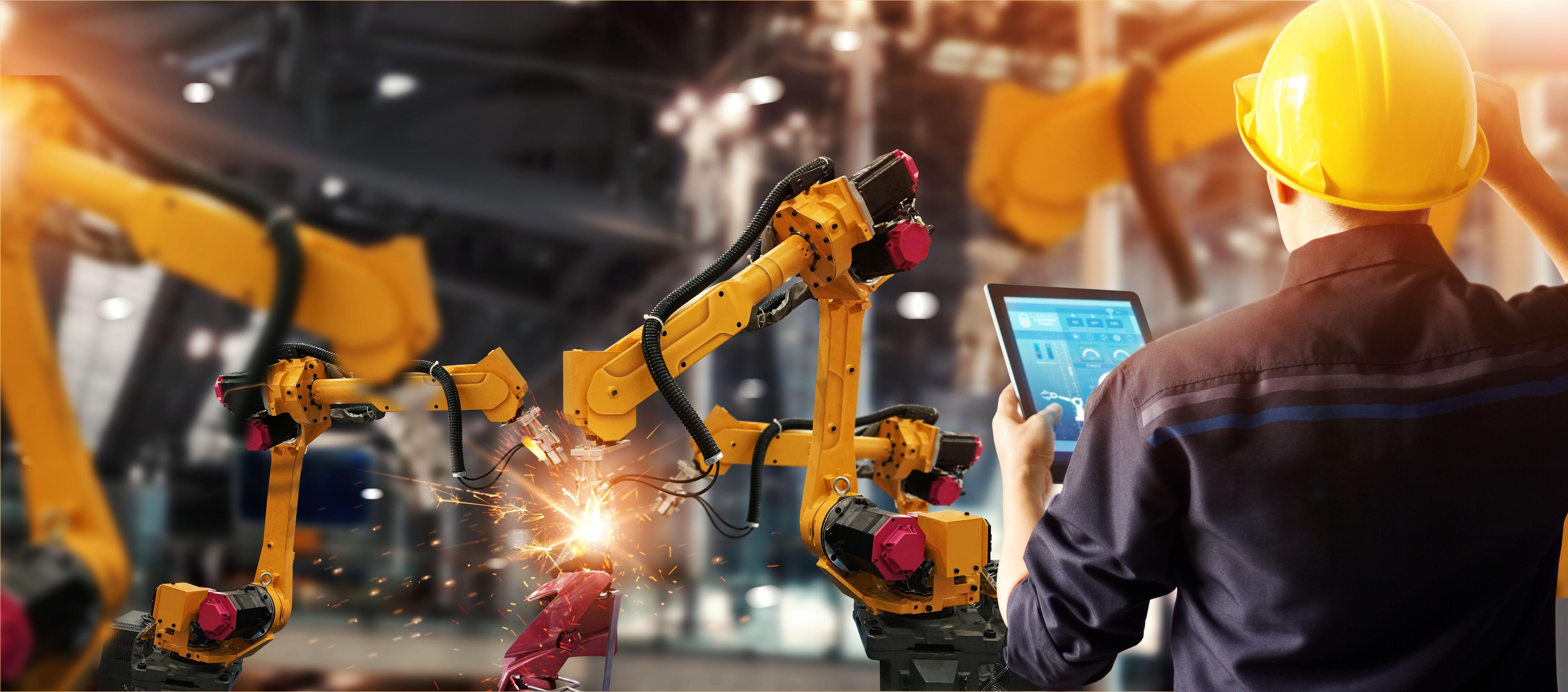 engineer-check-control-welding-robotics-automatic-arms-machine.jpg