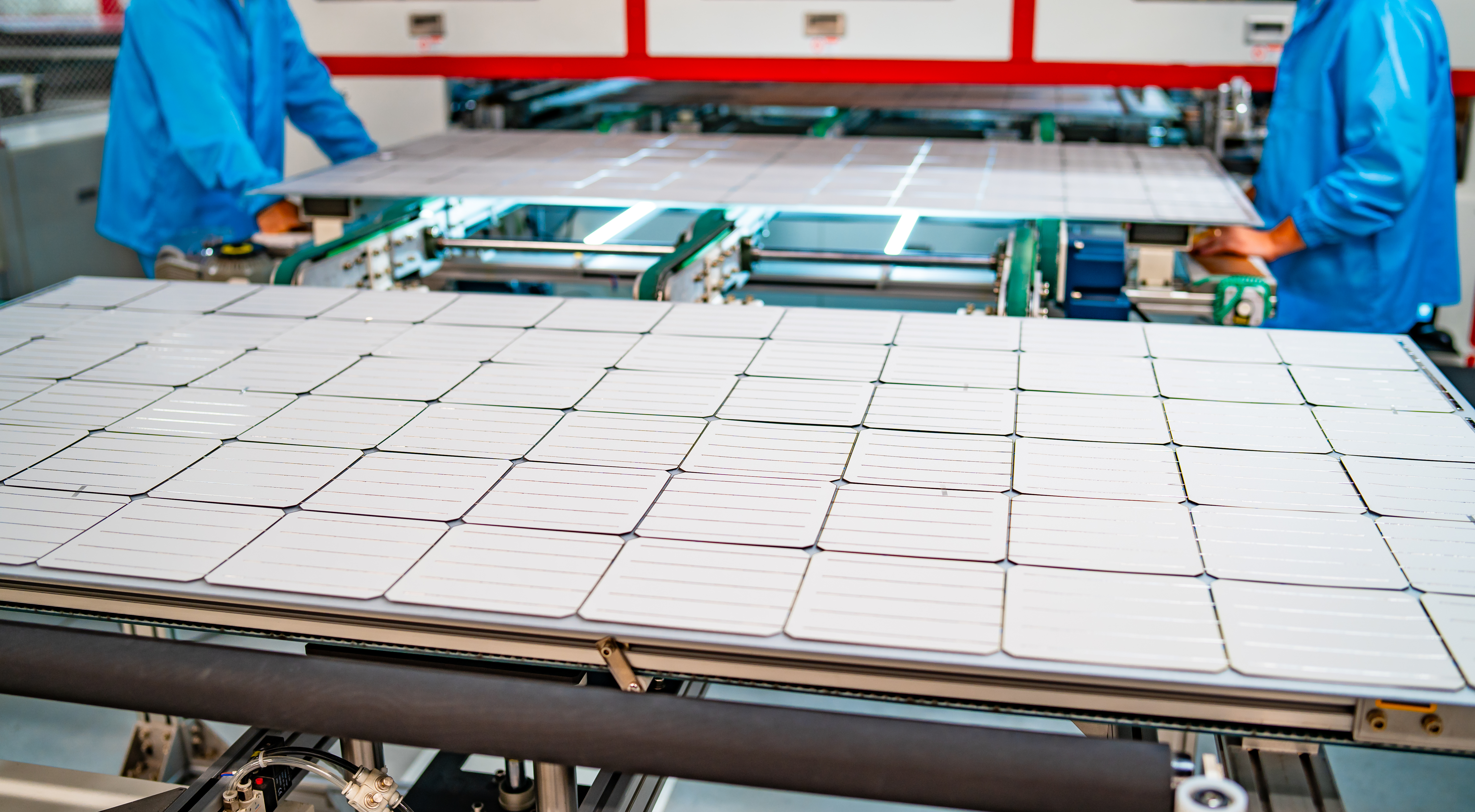 production of solar panels, men working in factory.