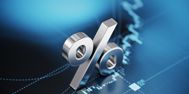 Percentage Sign Sitting over Blue Financial Graph Background - Stock Market and Finance Concept