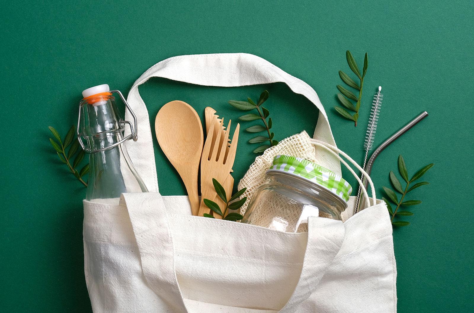 Reusable canvas shopper bag with eco-friendly items inside