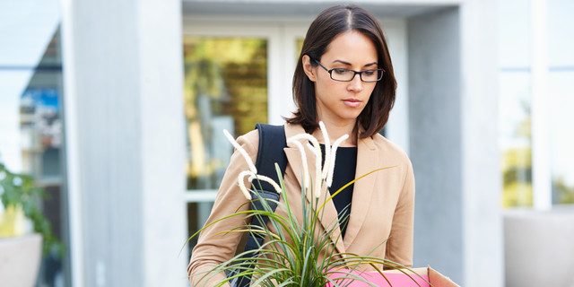 Redundant Businesswoman Leaving Office With Box