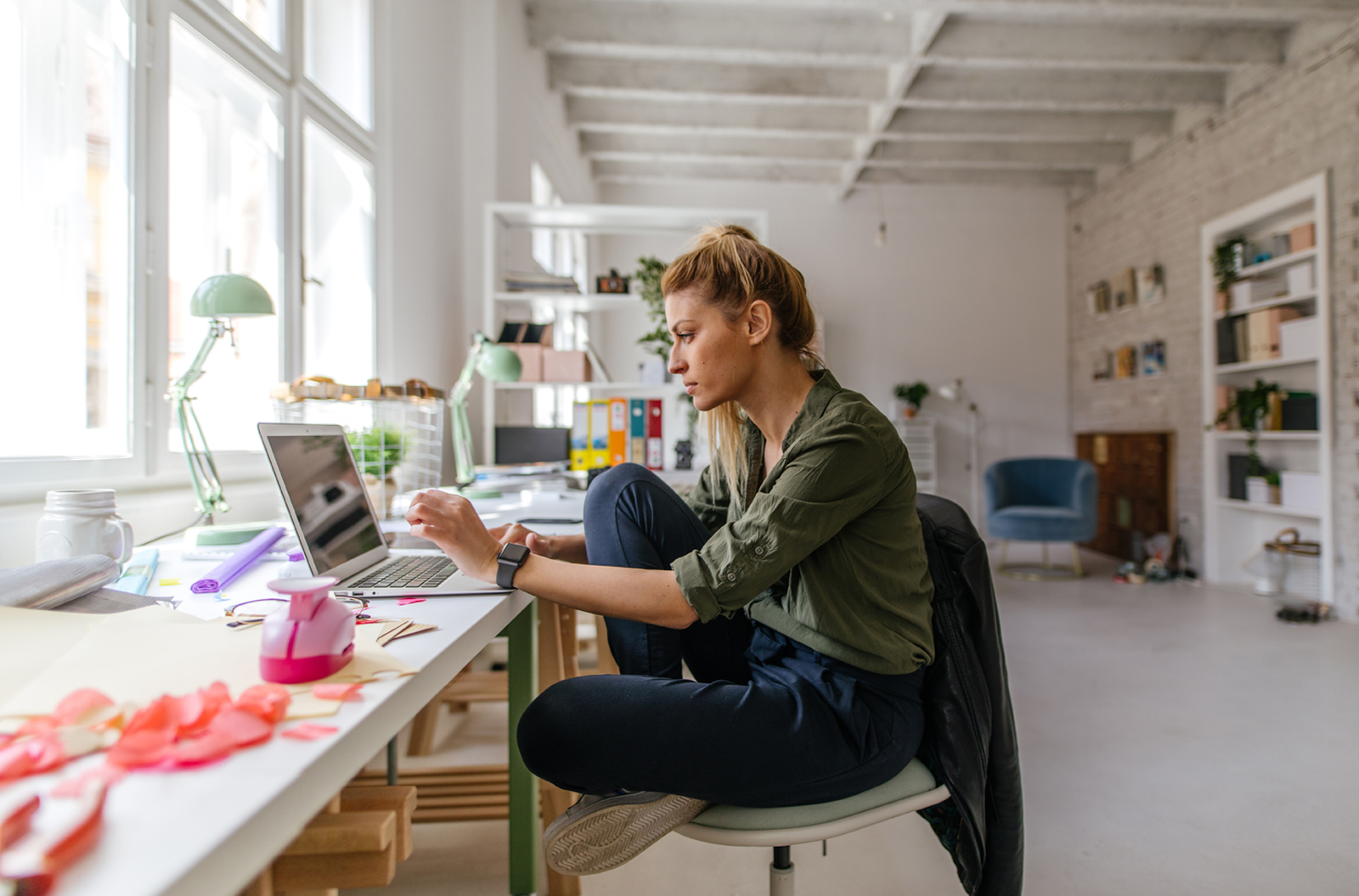 Woman on laptop computer sitting at her home office desk