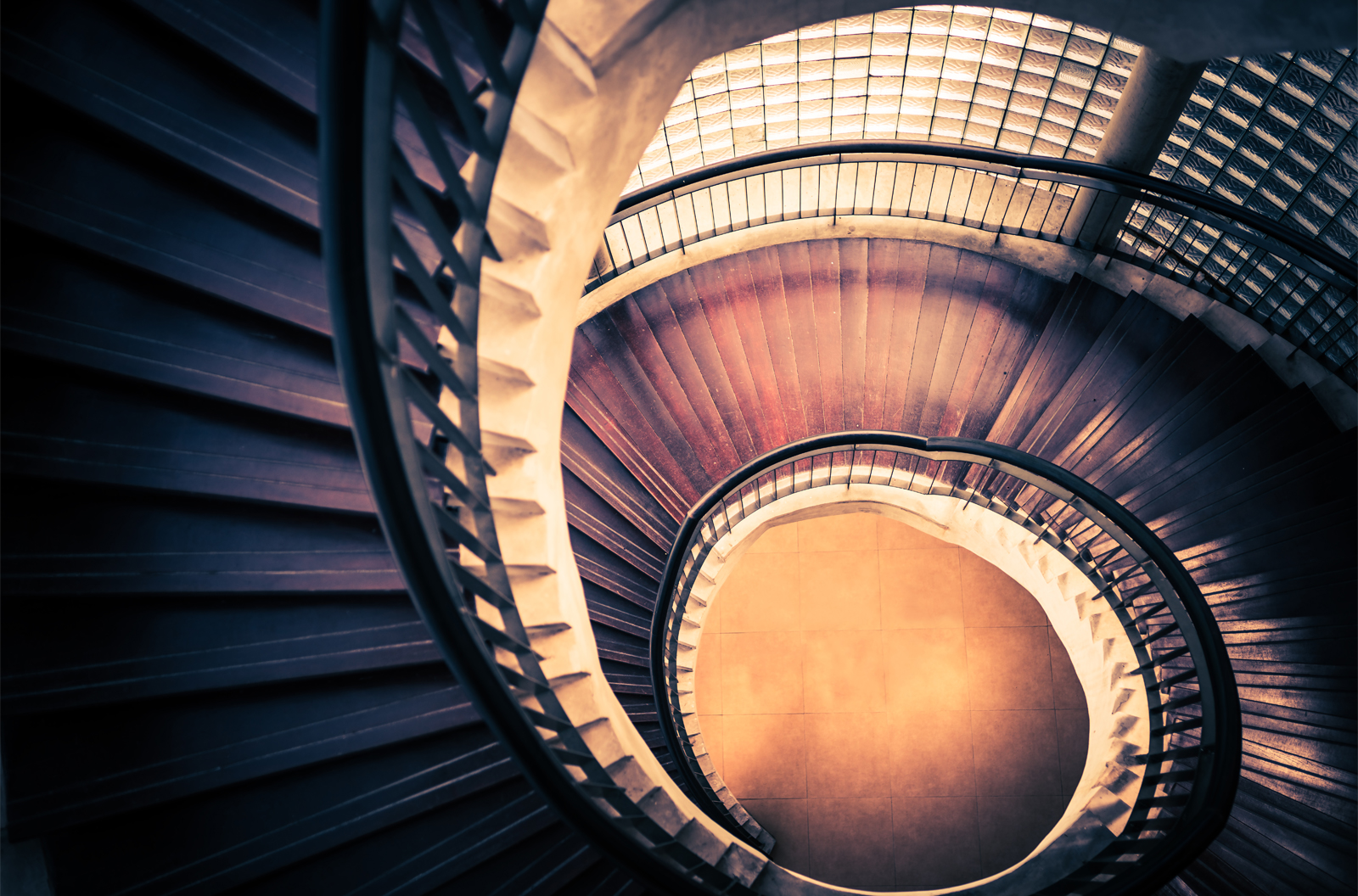 Top view of a spiral staircase to illustrate the Fibonacci Spiral in architecture