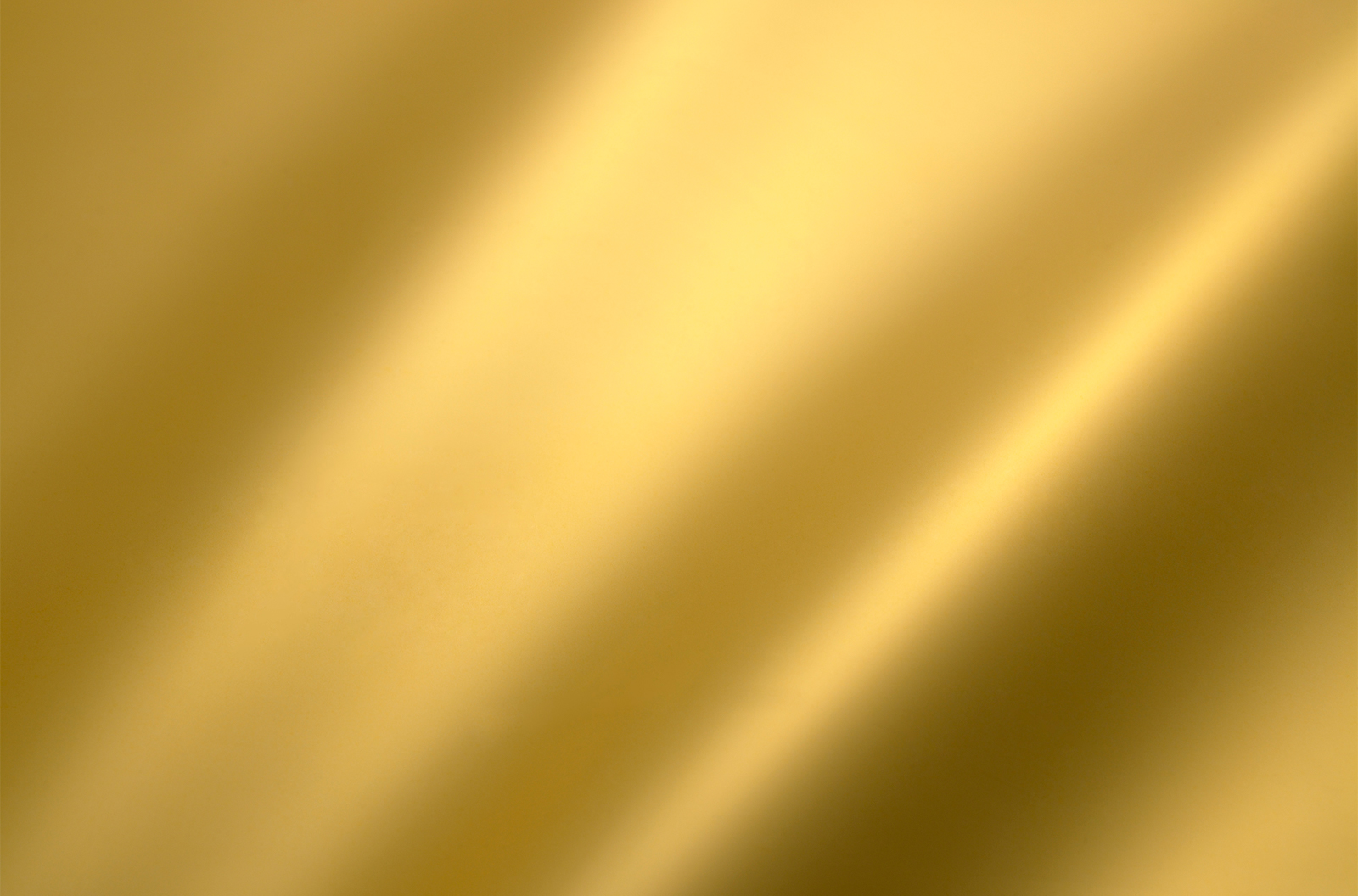 Golden metal sheet background with crease texture
