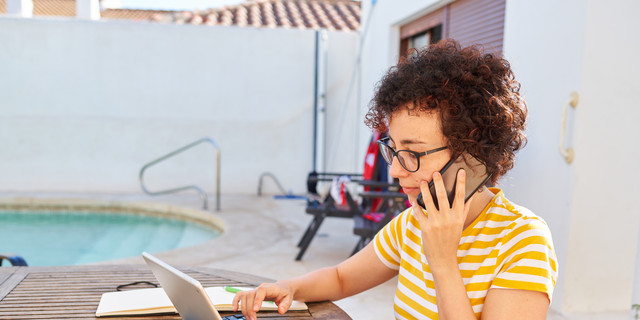 Young business woman telecommuting at an outdoor site