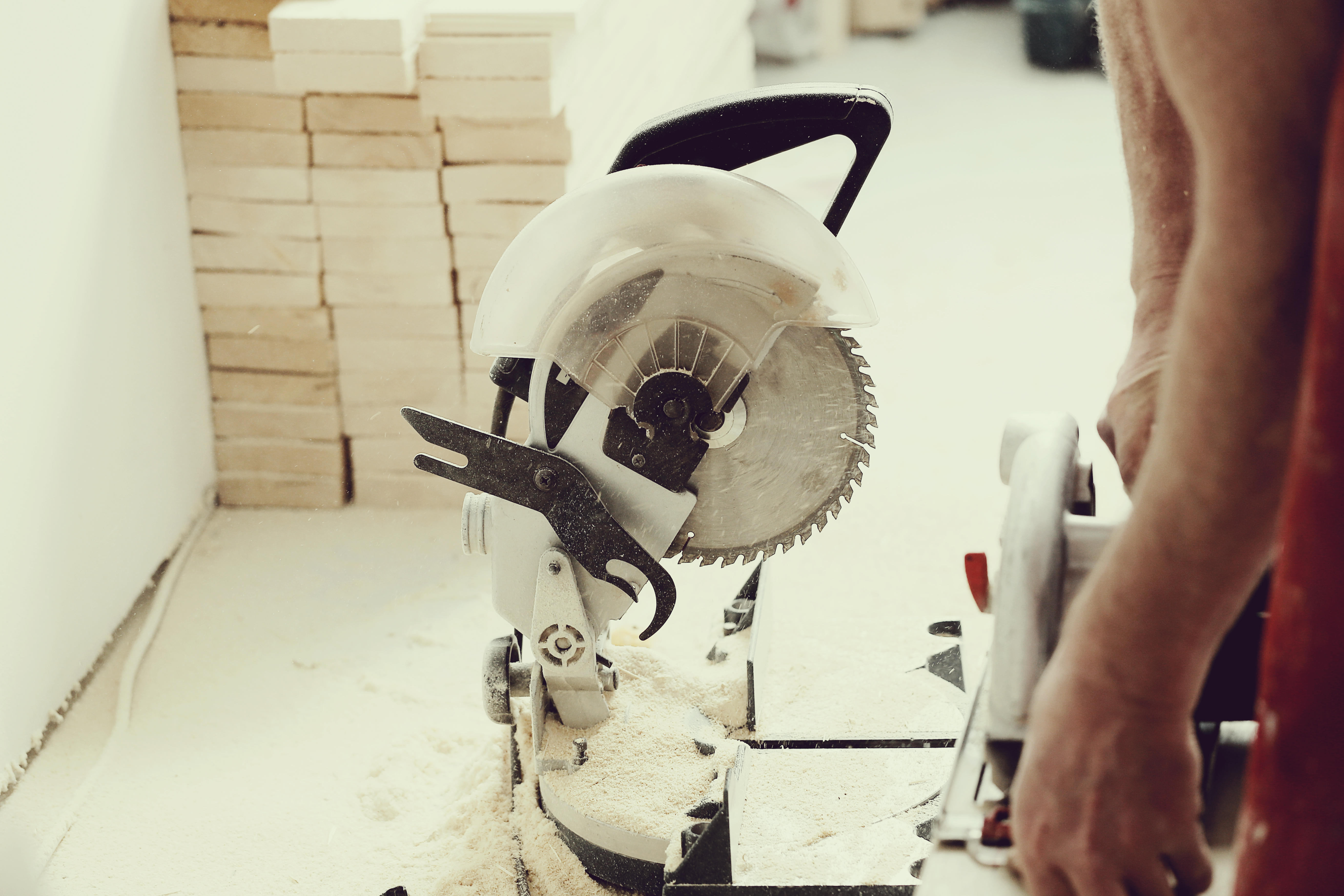 man-using-electric-saw-carpentry-shop.jpg
