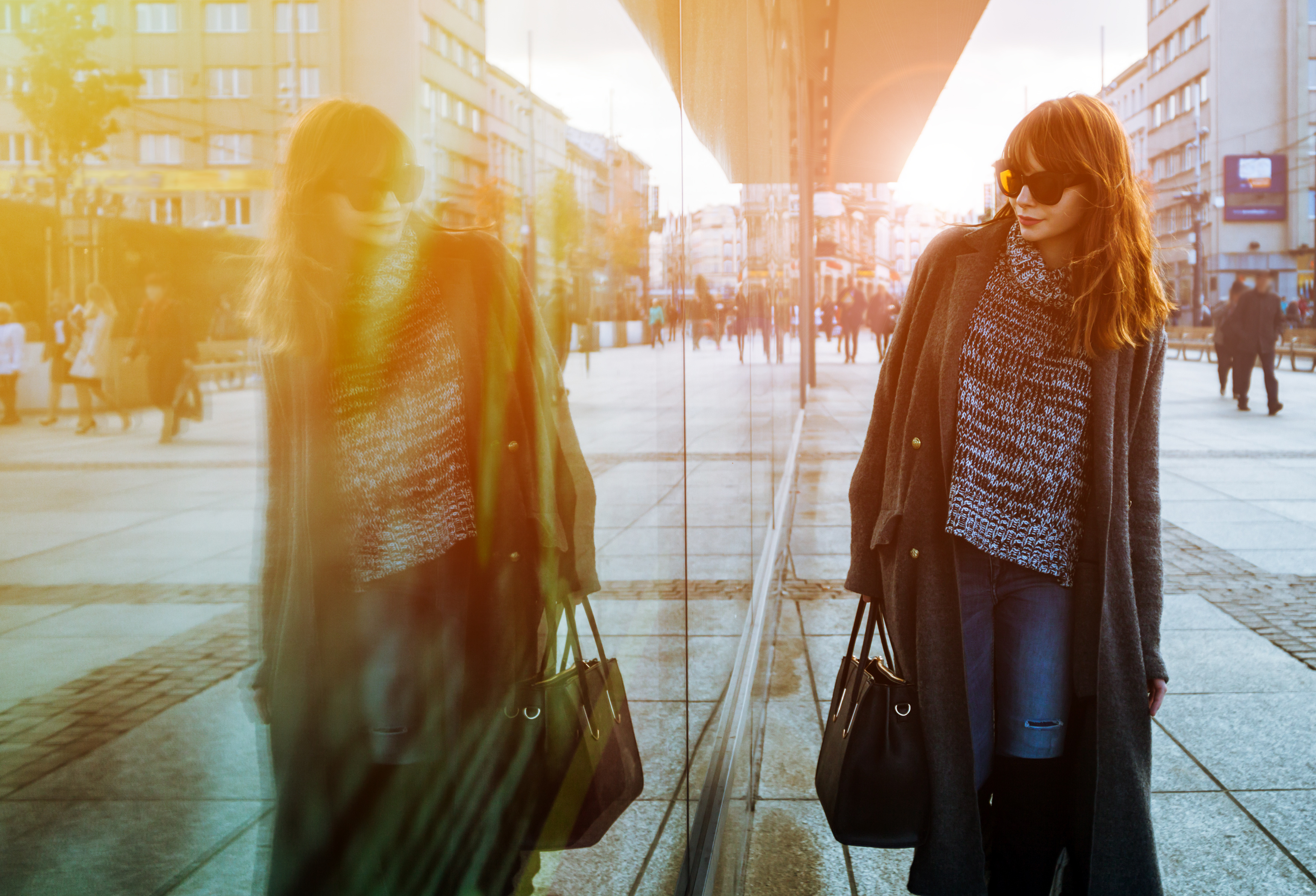 Woman walking on street and looking at shopping window