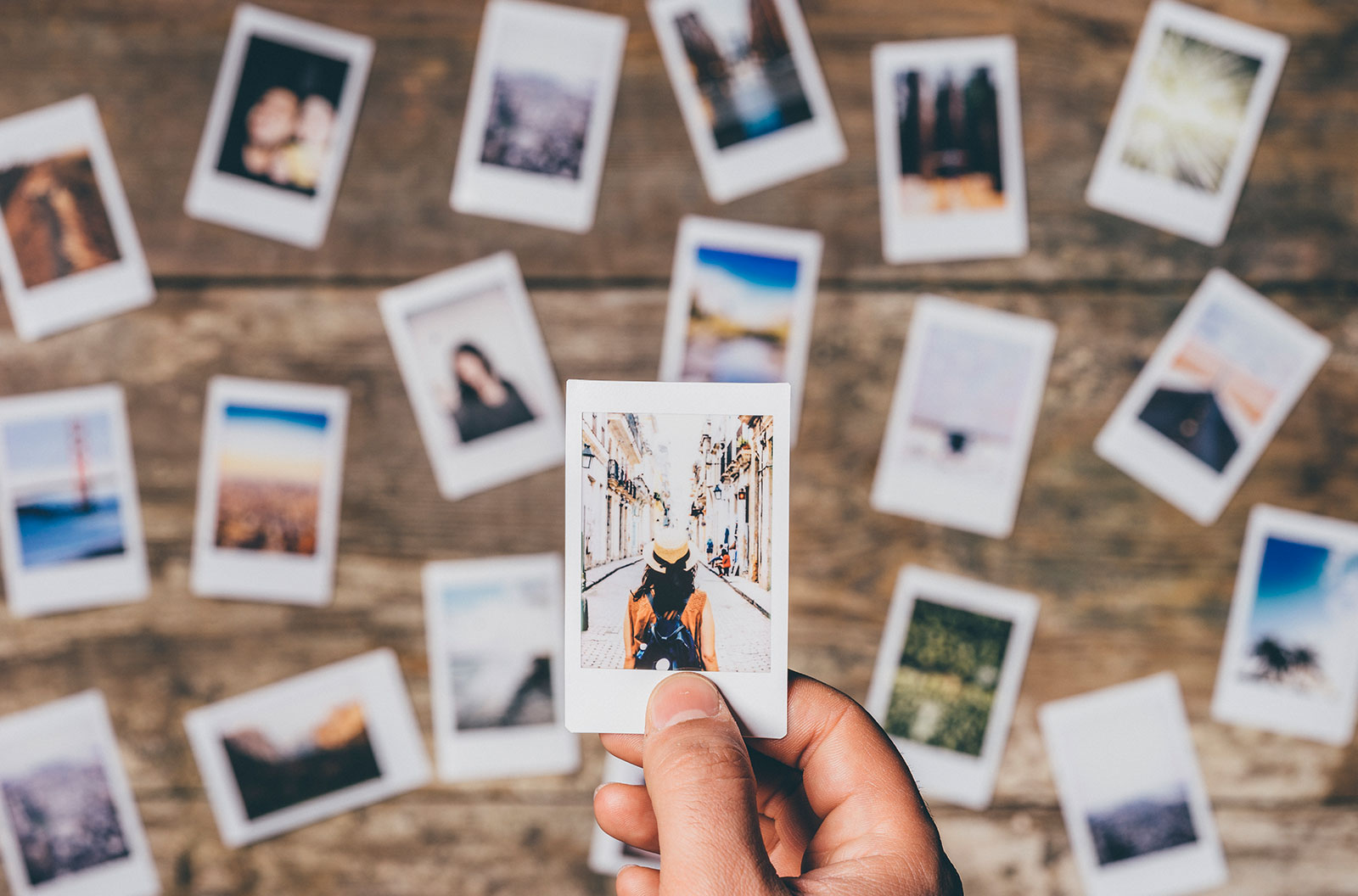 Top view of instant camera prints laid out on a table