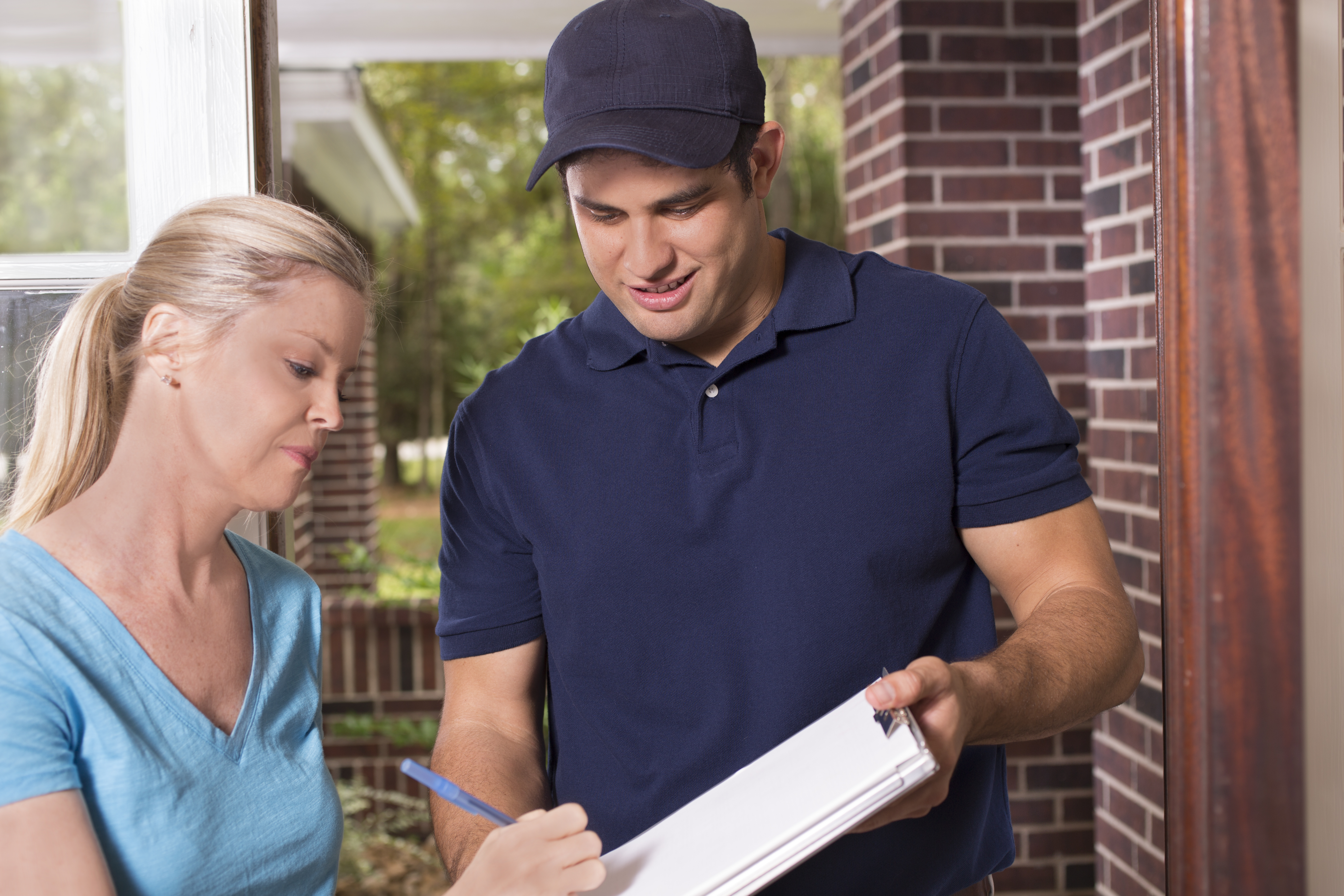 Repairman or delivery person at customer's front door.