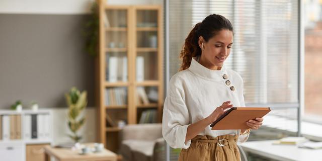 Modern Businesswoman Using Tablet