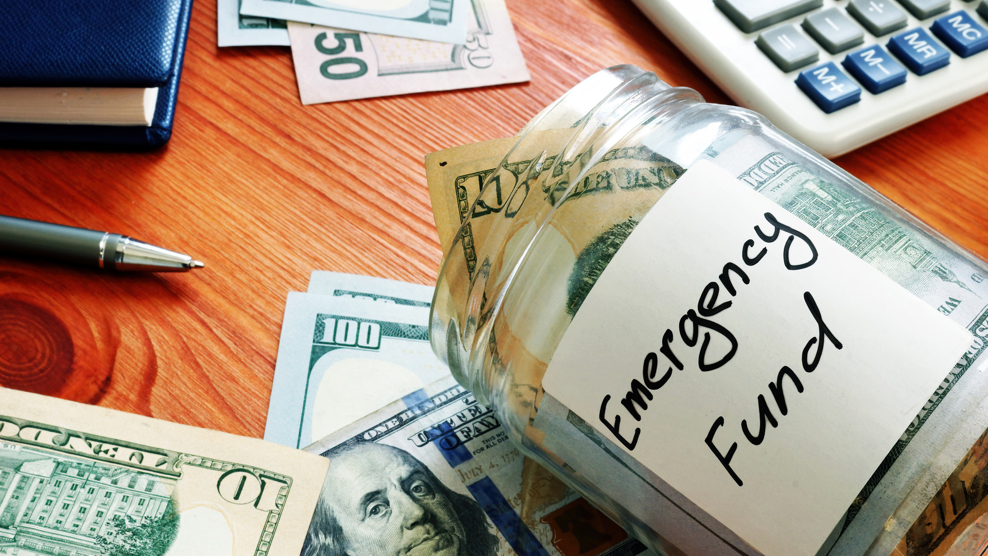 Emergency fund in the glass jar with cash.