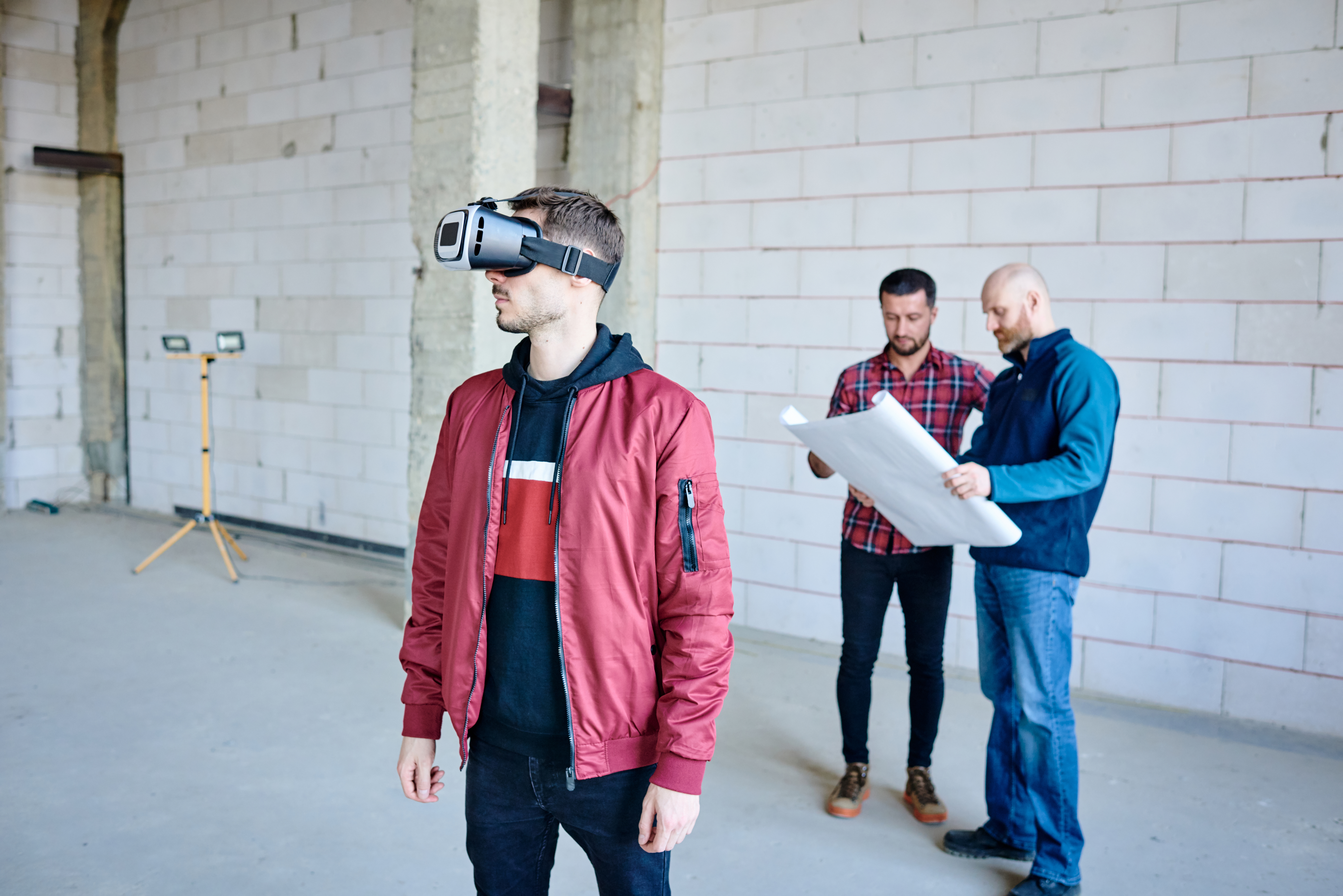 young-architect-designer-casualwear-vr-goggle-standing-inside-unfinished-building-watching-presentation-interiors.jpg