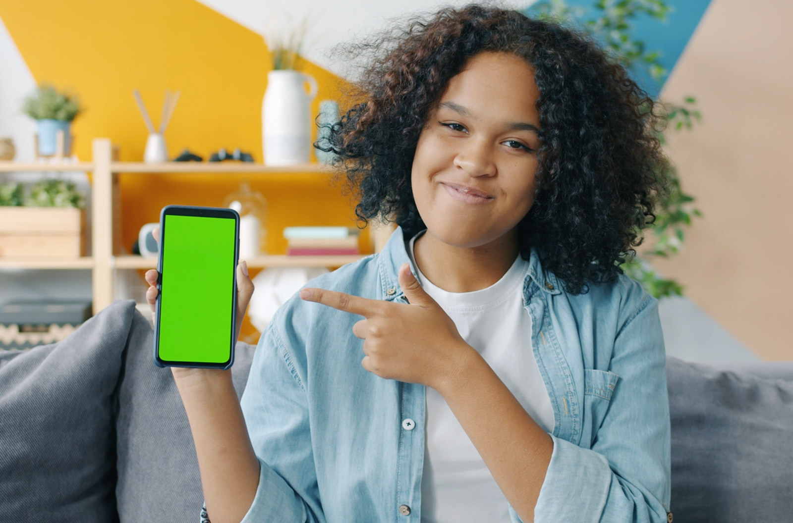 Slow motion of young woman holding smartphone pointing at screen