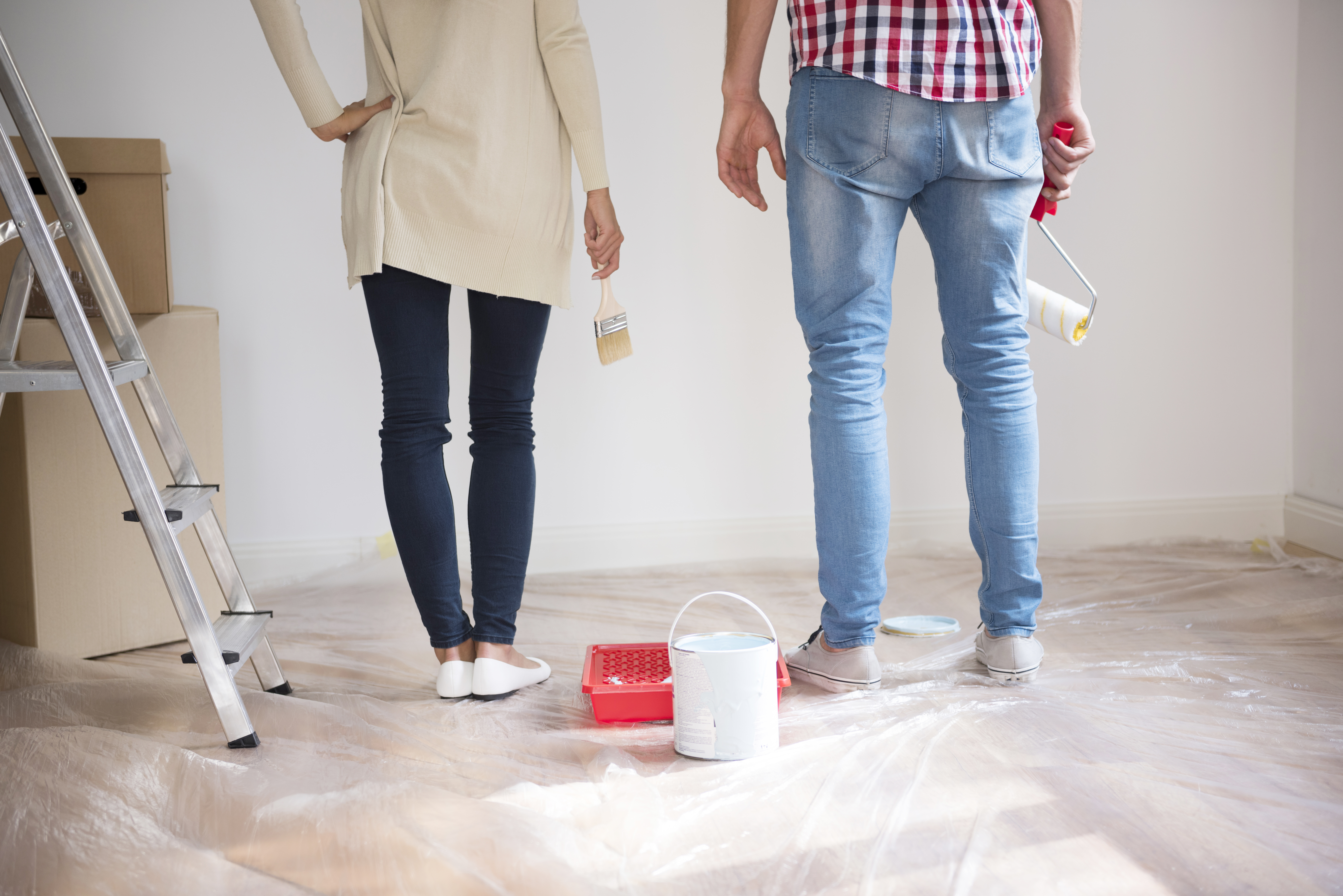 young-couple-painting-walls.jpg
