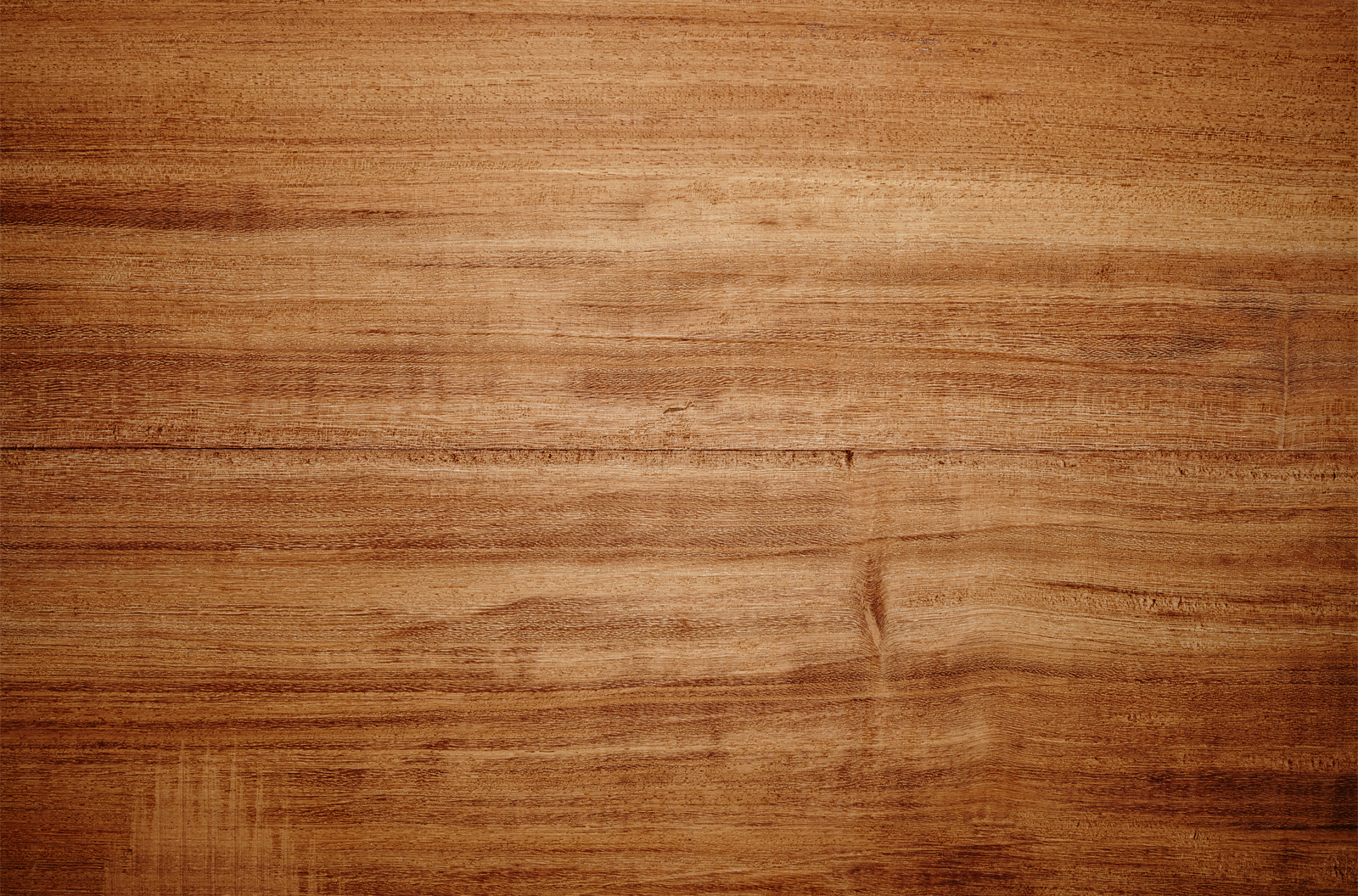 Overhead view of light brown wooden table